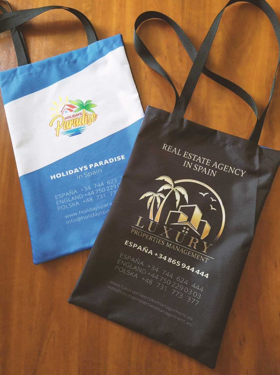 torby reklamowe z logo holiday paradise oraz luxuryproperties management