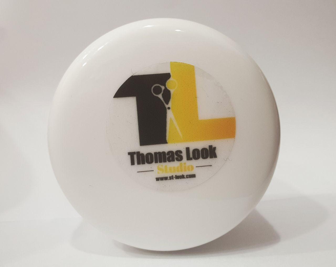 naklejki z logo Thomas Look